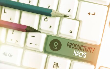 Writing note showing Productivity Hacks. Business concept for tricks that you get more done in the same amount of time