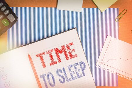 Text sign showing Time To Sleep. Business photo text a natural period of slumber or to be in state of inactivity Striped paperboard notebook cardboard office study supplies chart paper