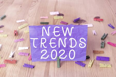 Writing note showing New Trends 2020. Business concept for general direction in which something is developing