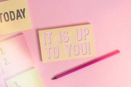 Text sign showing It Is Up To You. Business photo showcasing Used to tell an individual that they are the one to decide Close up view four multicolor blank notepads marker colored background Stock Photo