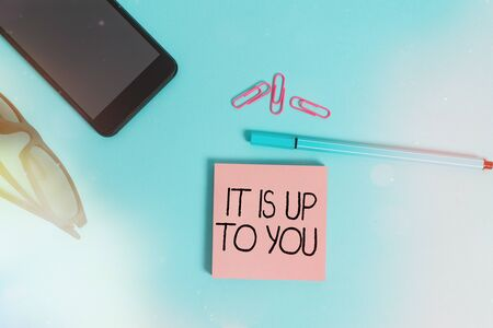 Writing note showing It Is Up To You. Business concept for Used to tell an individual that they are the one to decide Eyeglasses colored sticky note smartphone cell pen pastel background