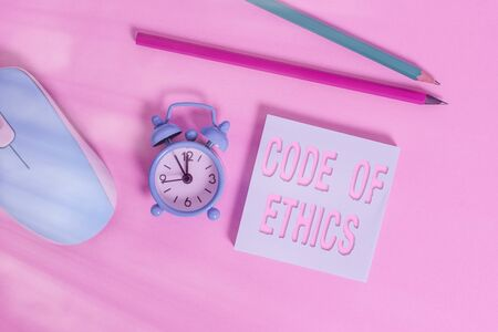 Text sign showing Code Of Ethics. Business photo showcasing basic guide for professional conduct and imposes duties Alarm clock wakeup blank notepad mouse markers colored background