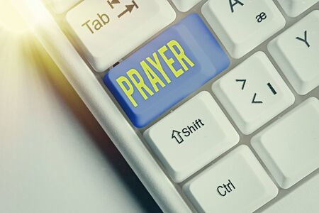Writing note showing Prayer. Business concept for solemn request for help or expression of thanks addressed to God Stock Photo