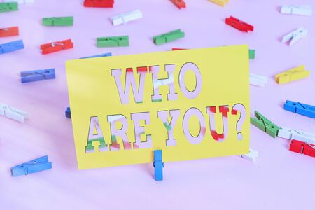 Text sign showing Who Are Youquestion. Business photo text someone asking your an individualal background or history Colored clothespin papers empty reminder pink floor background office pin