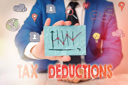 Handwriting text writing Tax Deductions. Conceptual photo an amount or cost that subtracted from someone s is income Stock fotó