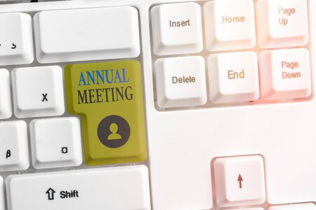 Writing note showing Annual Meeting. Business concept for yearly meeting of the general membership of an organization