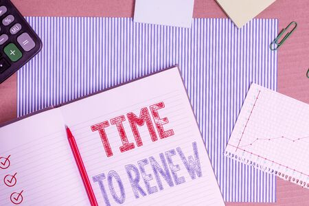 Text sign showing Time To Renew. Business photo text extending the period of time when something is valid Striped paperboard notebook cardboard office study supplies chart paper