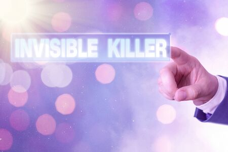 Writing note showing Invisible Killer. Business concept for presence into the air of a substance which are harmful