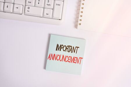 Handwriting text writing Important Announcement. Conceptual photo spoken statement that tells showing about something Empty note paper on the white background by the pc keyboard with copy space