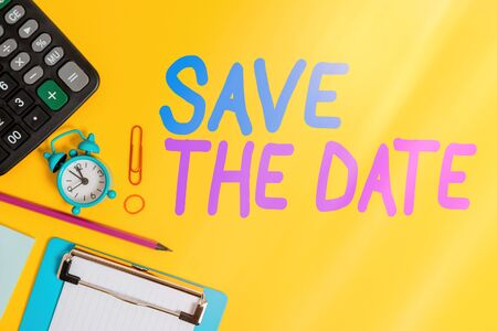Text sign showing Save The Date. Business photo showcasing reserve the mentioned future wedding date on their calendar Clock clips crushed note calculator pencil clipboard band color background