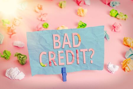 Word writing text Bad Creditquestion. Business photo showcasing inabilityof an individual to repay a debt on time and in full Colored crumpled papers empty reminder pink floor background clothespin