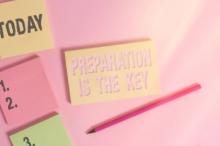 Text sign showing Preparation Is The Key. Business photo showcasing it reduces errors and shortens the activities Close up view four multicolor blank notepads marker colored background