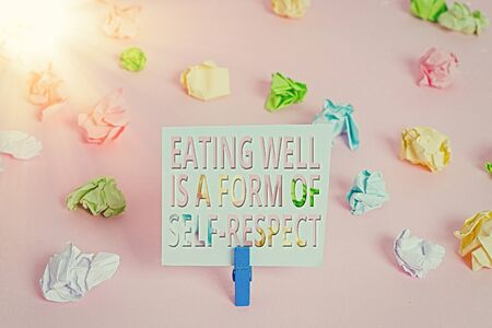 Word writing text Eating Well Is A Form Of Self Respect. Business photo showcasing a quote of promoting healthy lifestyle Colored crumpled papers empty reminder pink floor background clothespin