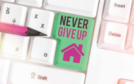Conceptual hand writing showing Never Give Up. Concept meaning be persistent to keep on trying to improve the condition