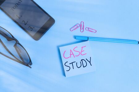 Word writing text Case Study. Business photo showcasing analysis and a specific research design for examining a problem Eyeglasses colored sticky note smartphone cell clips pen pastel background