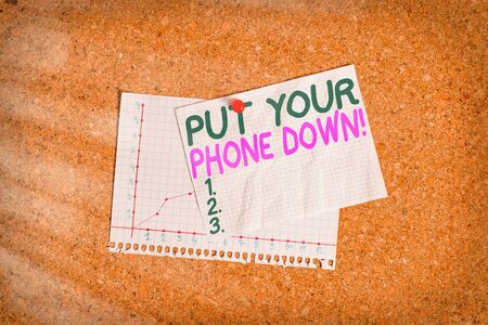Conceptual hand writing showing Put Your Phone Down. Concept meaning end telephone connection saying goodbye caller Corkboard size paper thumbtack sheet billboard notice board