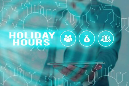 Text sign showing Holiday Hours. Business photo showcasing employee receives twice their normal pay for all hours Фото со стока