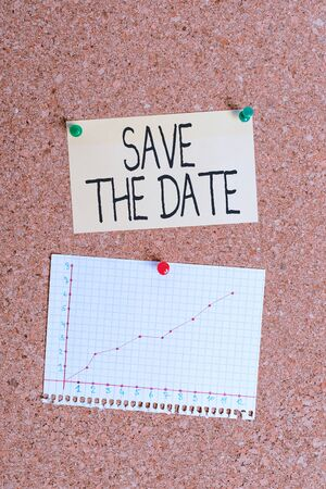 Handwriting text writing Save The Date. Conceptual photo reserve the mentioned future wedding date on their calendar Corkboard color size paper pin thumbtack tack sheet billboard notice board Banque d'images