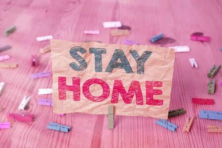 Conceptual hand writing showing Stay Home. Concept meaning not go out for an activity and stay inside the house or home