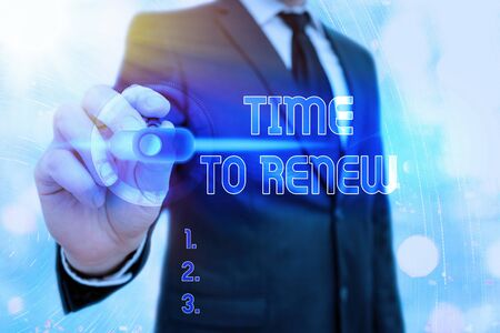 Writing note showing Time To Renew. Business concept for extending the period of time when something is valid