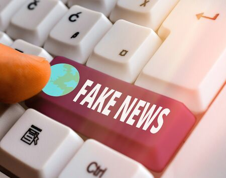 Conceptual hand writing showing Fake News. Concept meaning false information publish under the guise of being authentic news