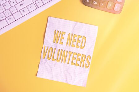 Conceptual hand writing showing We Need Volunteers. Concept meaning someone who does work without being paid for it Copy space on notebook with pc keyboard on the table