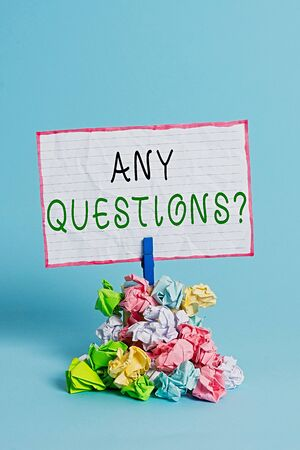 Conceptual hand writing showing Any Questions Question. Concept meaning you say write order to ask an individual about something Reminder pile colored crumpled paper clothespin wooden space