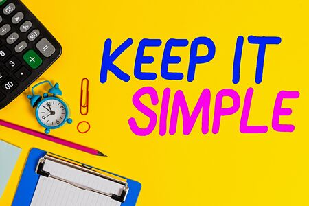 Text sign showing Keep It Simple. Business photo showcasing to make something easy to understand and not in fancy way Clock clips crushed note calculator pencil clipboard band color background