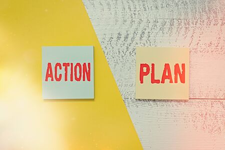 Text sign showing Action Plan. Business photo showcasing detailed plan outlining actions needed to reach goals or vision Two multicolor blank notepads colored paper sheet retro wooden background