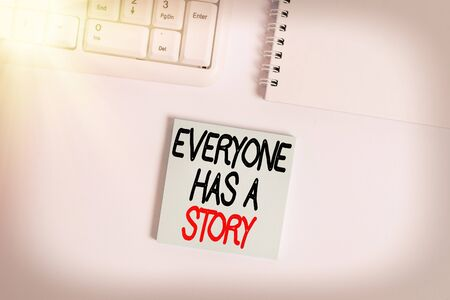 Handwriting text writing Everyone Has A Story. Conceptual photo account of past events in someones life or career Empty note paper on the white background by the pc keyboard with copy space Banque d'images