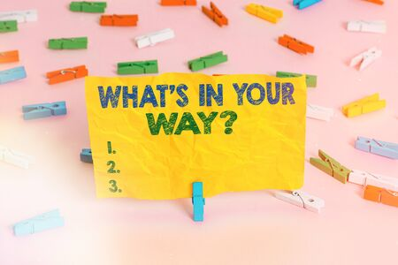 Handwriting text writing What S Is In Your Way question. Conceptual photo someone needs for a particular action Colored clothespin papers empty reminder pink floor background office pin