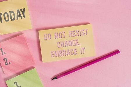 Text sign showing Do Not Resist Change Embrace It. Business photo showcasing Be open to changes try new things Positive Close up view four multicolor blank notepads marker colored background
