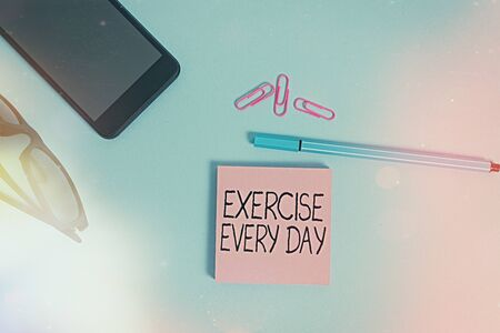 Writing note showing Exercise Every Day. Business concept for move body energetically in order to get fit and healthy Eyeglasses colored sticky note smartphone cell pen pastel background