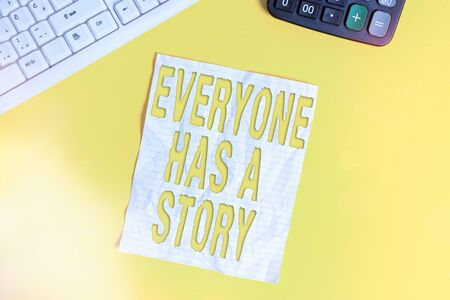 Conceptual hand writing showing Everyone Has A Story. Concept meaning account of past events in someones life or career Copy space on notebook with pc keyboard on the table
