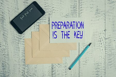Conceptual hand writing showing Preparation Is The Key. Concept meaning it reduces errors and shortens the activities Envelopes marker ruled paper smartphone wooden background