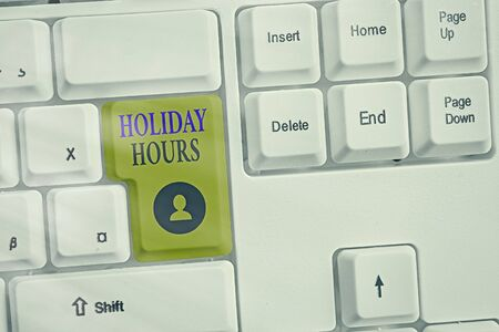 Writing note showing Holiday Hours. Business concept for employee receives twice their normal pay for all hours