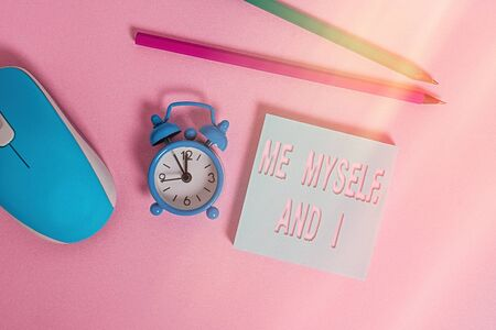Text sign showing Me Myself And I. Business photo showcasing used by speaker to refer to herself as the object of a verb Alarm clock wakeup blank notepad mouse markers colored background