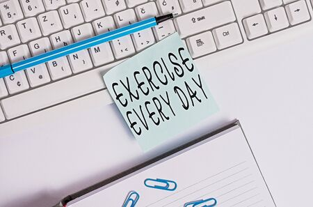 Writing note showing Exercise Every Day. Business concept for move body energetically in order to get fit and healthy Flat lay above blank copy space sticky notes with business concept
