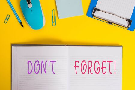 Writing note showing Don T Forget. Business concept for used to remind someone about an important fact or detail Clipboard sheet striped notepad mouse pencil note colored background
