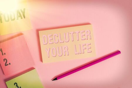 Text sign showing Declutter Your Life. Business photo showcasing To eliminate extraneous things or information in life Close up view four multicolor blank notepads marker colored background