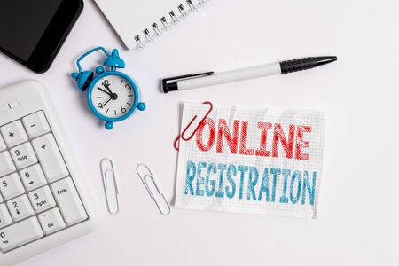 Conceptual hand writing showing Online Registration. Concept meaning System for subscribing or registering via the Internet Flat lay above computer mobile phone clock pencil and note paper