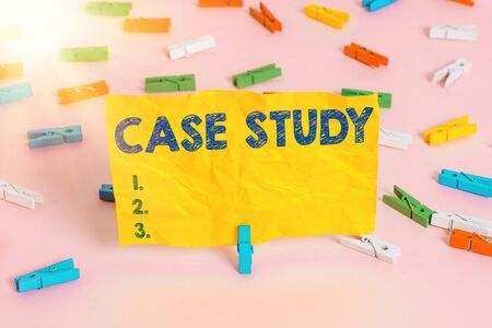 Handwriting text writing Case Study. Conceptual photo analysis and a specific research design for examining a problem Colored clothespin papers empty reminder pink floor background office pin Stok Fotoğraf