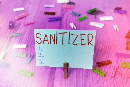 Writing note showing Sanitizer. Business concept for liquid or gel generally used to decrease infectious agents Zdjęcie Seryjne