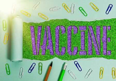 Conceptual hand writing showing Vaccine. Concept meaning preparation of killed microorganisms or living attenuated organisms