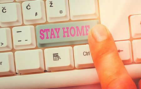 Writing note showing Stay Home. Business concept for not go out for an activity and stay inside the house or home