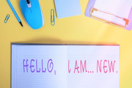 Writing note showing Hello I Am New. Business concept for used greeting or begin telephone conversation Clipboard sheet striped notepad mouse pencil note colored background Фото со стока