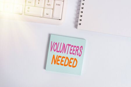 Handwriting text writing Volunteers Needed. Conceptual photo need work or help for organization without being paid Empty note paper on the white background by the pc keyboard with copy space