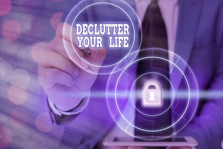 Writing note showing Declutter Your Life. Business concept for To eliminate extraneous things or information in life