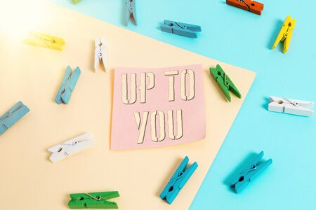 Writing note showing Up To You. Business concept for it is used to indicate a decision or choices of an individual Colored clothespin paper reminder with yellow blue background