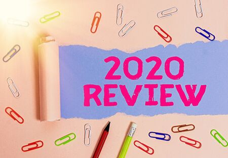 Conceptual hand writing showing 2020 Review. Concept meaning New trends and prospects in tourism or services for 2020